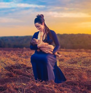 a woman breastfeeding in a tranquil environment